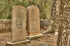 Two tombstones marking the graves of sisters who died during infancy at the Chapel of Ease Ruins in Saint Helena Island, SC on Sunday, February 22, 2015. Copyright 2015 Jason Barnette  The chapel was building in the mid-1700's to serve the families of plantation owners on Saint Helena Island. In 1886 a forest fire destroyed the church, leaving only the walls and a single pillar standing.   Today the grounds are maintained by Parish Church of St. Helena. The ruins are open to the public 24/7 for respectful exploration, and permits can be acquired for photo shoots and weddings.