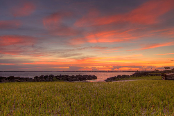 A warm sunset viewed from a public beach access on Sullivan's Island, SC on Sunday, July 6, 2014. Copyright 2014 Jason Barnette