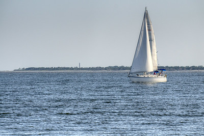 A sailboat moves through the water near Sullivan's Island, SC on Saturday, September 7, 2013. Copyright 2013 Jason Barnette
