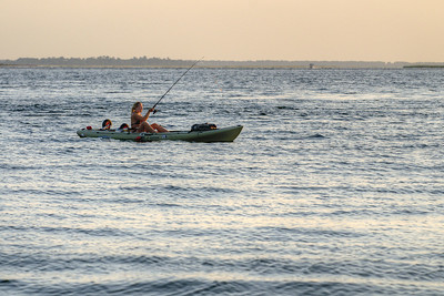 A woman fishes from a kayak in Sullivan's Island, SC on Saturday, September 7, 2013. Copyright 2013 Jason Barnette