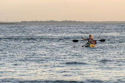 A woman takes a self-portrait from a kayak in Sullivan's Island, SC on Saturday, September 7, 2013. Copyright 2013 Jason Barnette