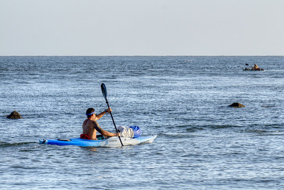 A man kayaks across the water near Sullivan's Island, SC on Saturday, September 7, 2013. Copyright 2013 Jason Barnette