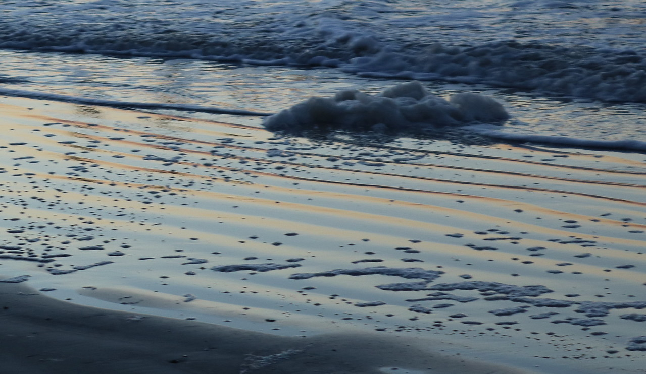 Sea Foam in the Surf at Dawn