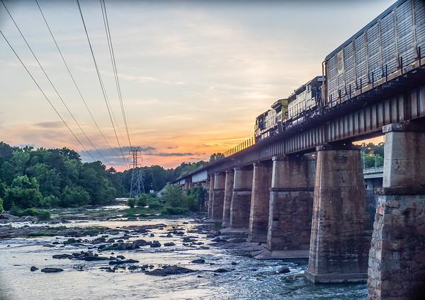 Camera, sunset, and a train.  No tripod, no long exposure.