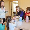 JENN SMITH — THE BERKSHIRE EAGLE <br /> Homeschool family Aimee and Eddie Barrett, 10, of Pittsfield, dish out ingredients to make slime during a South County STEM program. Eliza Cass, 5, takes a cup of pink goo, as her younger sister, Rosalie, 3, waits for her turn, and mom, Kristine Cass of Lenox, looks on.