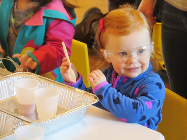 JENN SMITH — THE BERKSHIRE EAGLE <br /> Two-and-a-half-year-old Charlotte Burke of Pittsfield has her lab goggles on and is ready to mix ingredients to make 'slime' during last Friday's South County STEM program at the Lenox Community Center. The program is coordinated through a partnership with South Berkshire Kids and the Berkshire Museum.