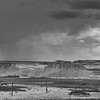 Badlands with rain in the distance