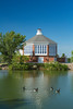 The Terry Redlin Pavilion with reflections in a pond in Watertown, South Dakota, USA.