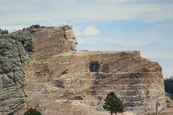 The Crazy Horse Memorial in the Black Hills of South Dakota.  When completed, the carving will be 641 feet long by 563 feet high.  Crazy Horse's head alone is 87 feet high.