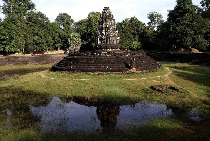 The solitary temple of Neak Pean set in the middle of a reservoir, Cambodia