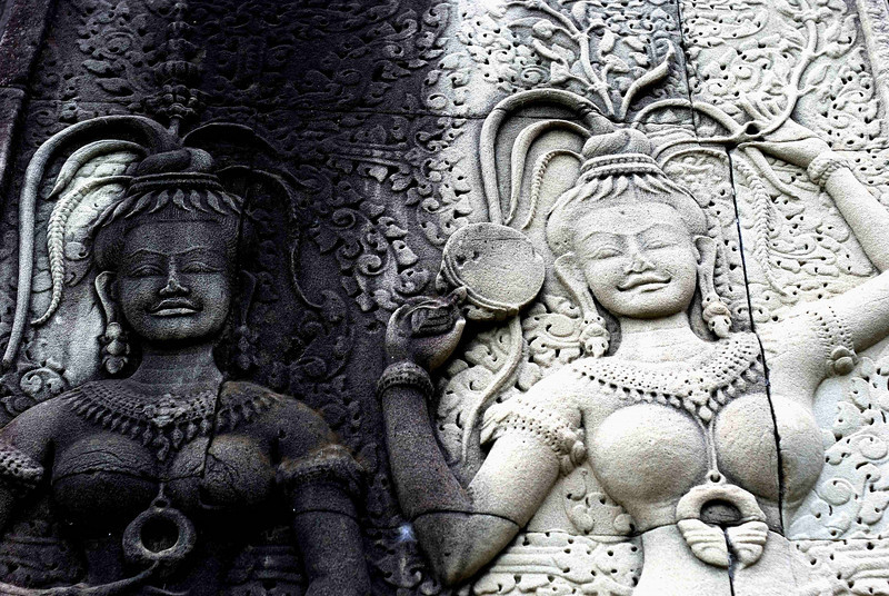 Restoration at Angkor Vat - the idol on the right is in the process of being restored