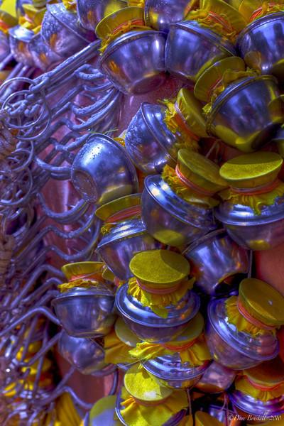 hooks holding pots onto skin at Thaipusam Festival