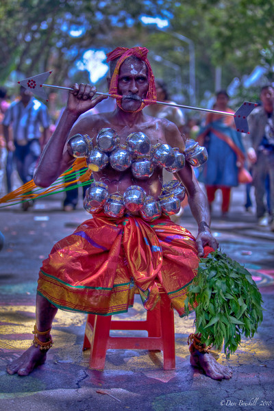 Man resting during pilgrimage at Thaipusam
