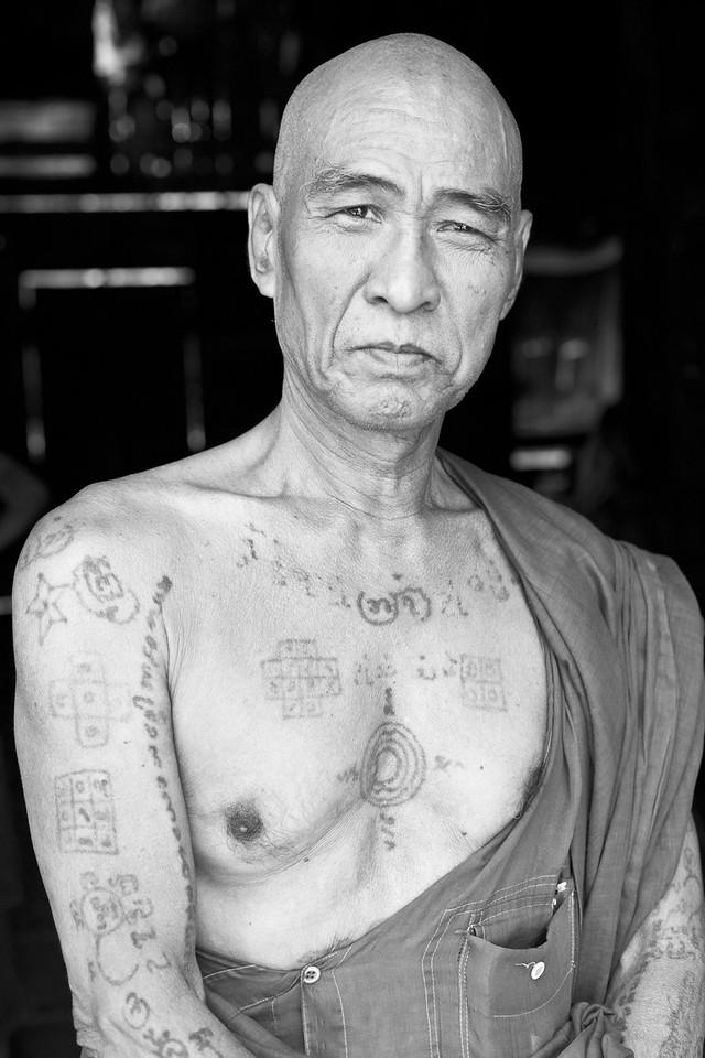 Monk shows his tattoos earned as a kickboxer, Tingaza Kyaung, Mandalay