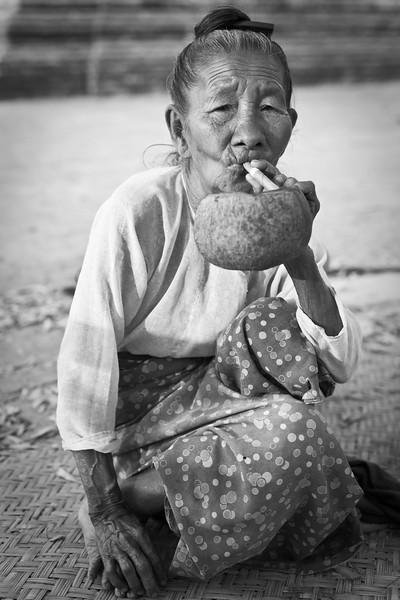 Woman with cheroot and ashtray, Bagan