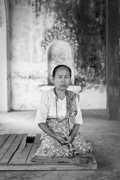 Woman deep in prayer, Pahtodawgyi, Amarapura