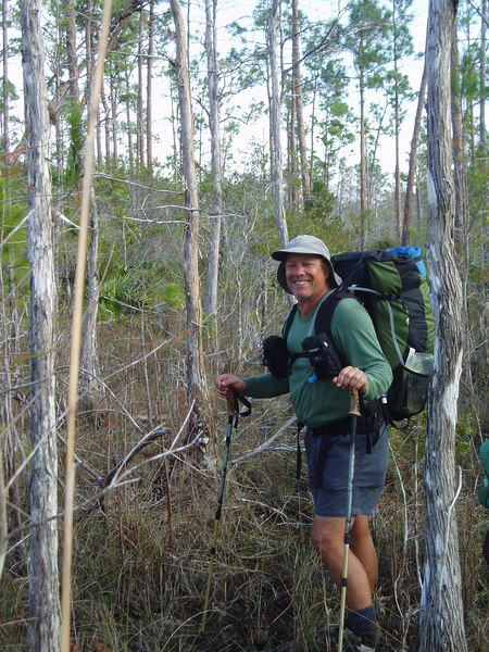 Backpacking Big Cypress<br /> Wading a cypress dome<br /> PHOTO CREDIT: Robert Coveney / Florida Trail Association