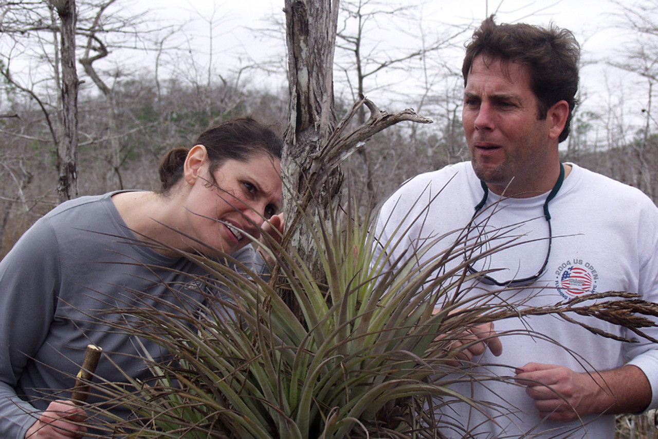 Hikers Juliet Schwarz and Robert Kirby stop to check out an orchid.   <br /> PHOTO CREDIT: Donn Brown / Florida Trail Association
