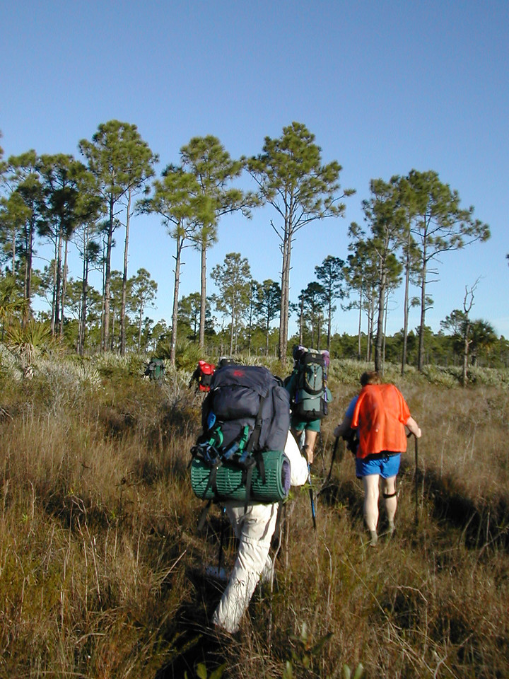 Backpackers enter the open prairies of Corbett WMA<br /> photo credit: Sandra Friend / Florida Trail Association