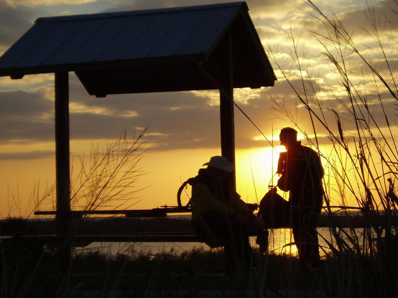 Hikers at a rest stop along Lake Okeechobee<br /> location: Okeechobee<br /> PHOTO CREDIT: Robert Coveney / Florida Trail Association