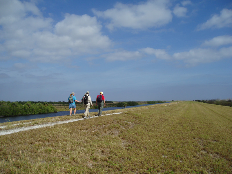 Hikers on the Herbert Hoover Dike<br /> PHOTO CREDIT: Robert Coveney / Florida Trail Association