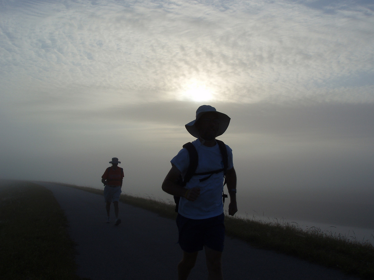 Hikers on a misty morning<br /> PHOTO CREDIT: Robert Coveney / Florida Trail Association