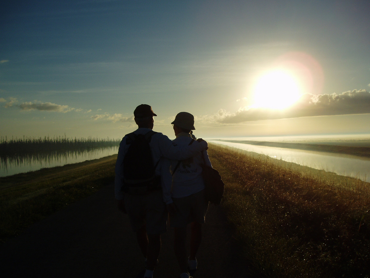 Hikers along the Rim Canal, Moore Haven<br /> PHOTO CREDIT: Robert Coveney / Florida Trail Association