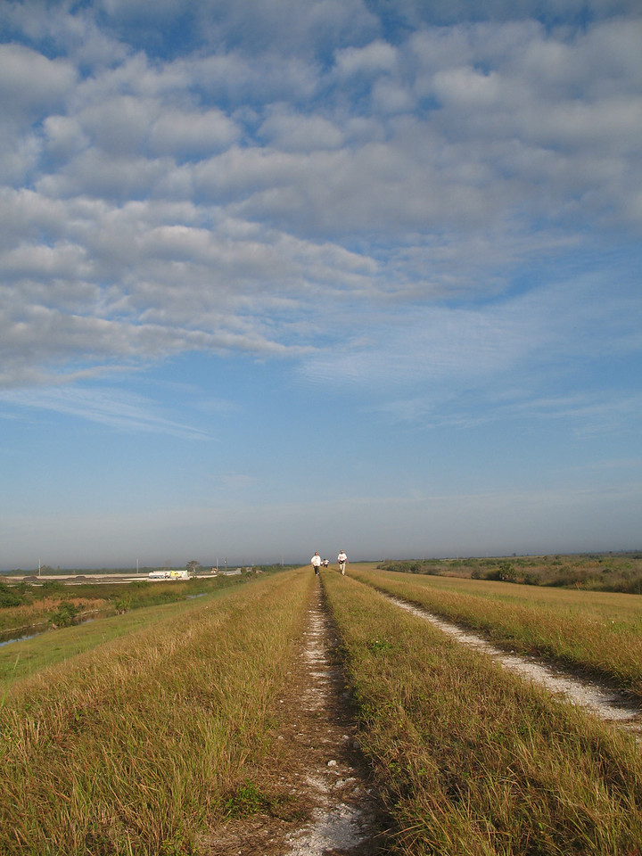 Hikers approach Moore Haven during the Big O Hike<br /> PHOTO CREDIT: Sandra Friend / Florida Trail Association