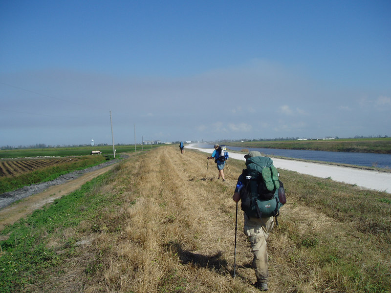 Hiking along the Miami Canal<br /> location: near Lake Harbor<br /> PHOTO CREDIT: Robert Coveney / Florida Trail Association