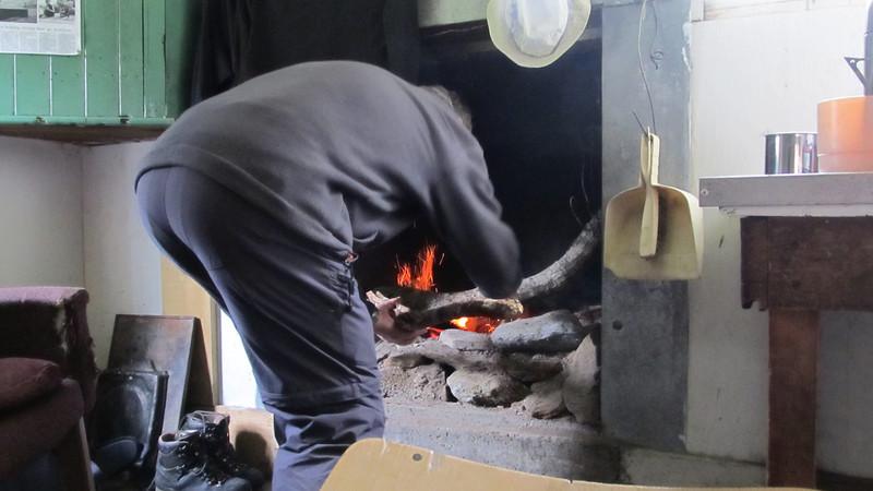 Dad enjoying making a fire.