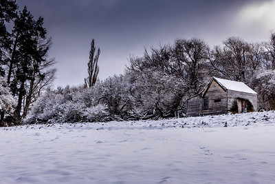 Cabin in snowy field