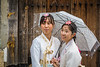 Koreans in traditional dress in Bukchok Hanok Village, Seoul, South Korea, Asia.