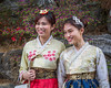 Koreans in traditional dress in Bukchok Hanok Village, Seoul, South Korea, Asia.