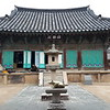 Город Кёнджу. Буддийский храм Пульгукса. Золотая статуя свинки.