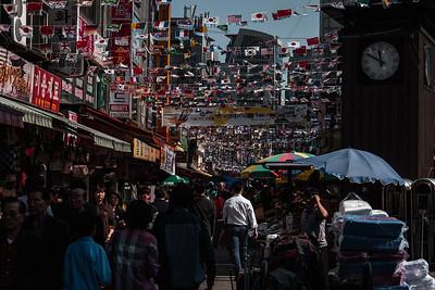 View Down a Busy Street in Namdaemun Market in Seoul South Korea