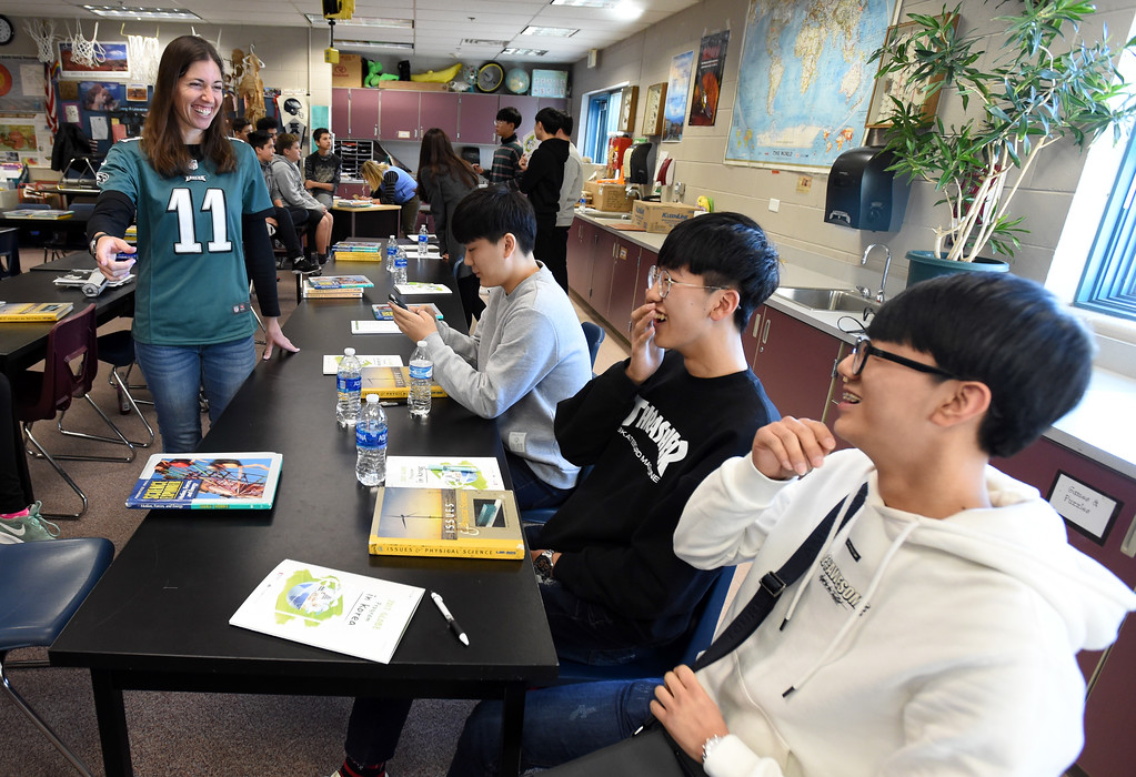 . Westview teacher, Jaime Sneider, left, jokes with Jae Hyeon Kim, left, Jae Hyeon Shin, and Su Hyeon Kim in class. South Korean high school students  visited Westview Middle School in Longmont on Thursday as part of NASA\'s GLOBE Program. Cliff Grassmick  Photographer January 11, 2018