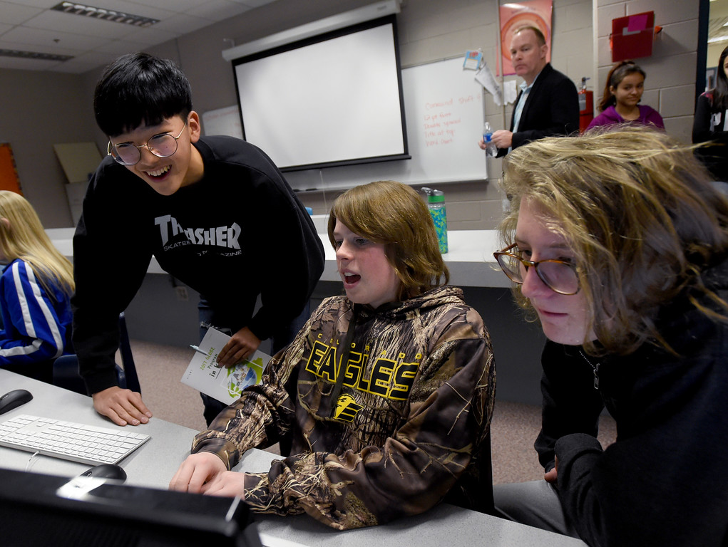 . Jae Hyeon Shin, left, is shown wildlife images by Zach Heil and Al Dworak. South Korean high school students  visited Westview Middle School in Longmont on Thursday as part of NASA\'s GLOBE Program. Cliff Grassmick  Photographer January 11, 2018