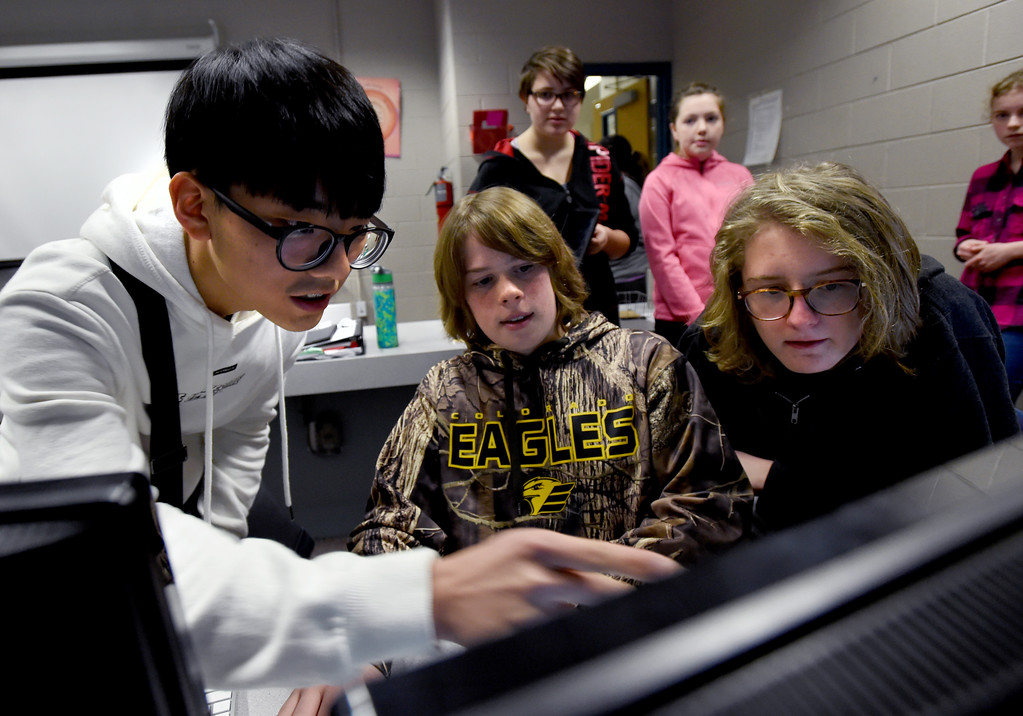 . Su Hyeon Kim, left, is shown wildlife images by Zach Heil and Al Dworak. South Korean high school students  visited Westview Middle School in Longmont on Thursday as part of NASA\'s GLOBE Program. Cliff Grassmick  Photographer January 11, 2018