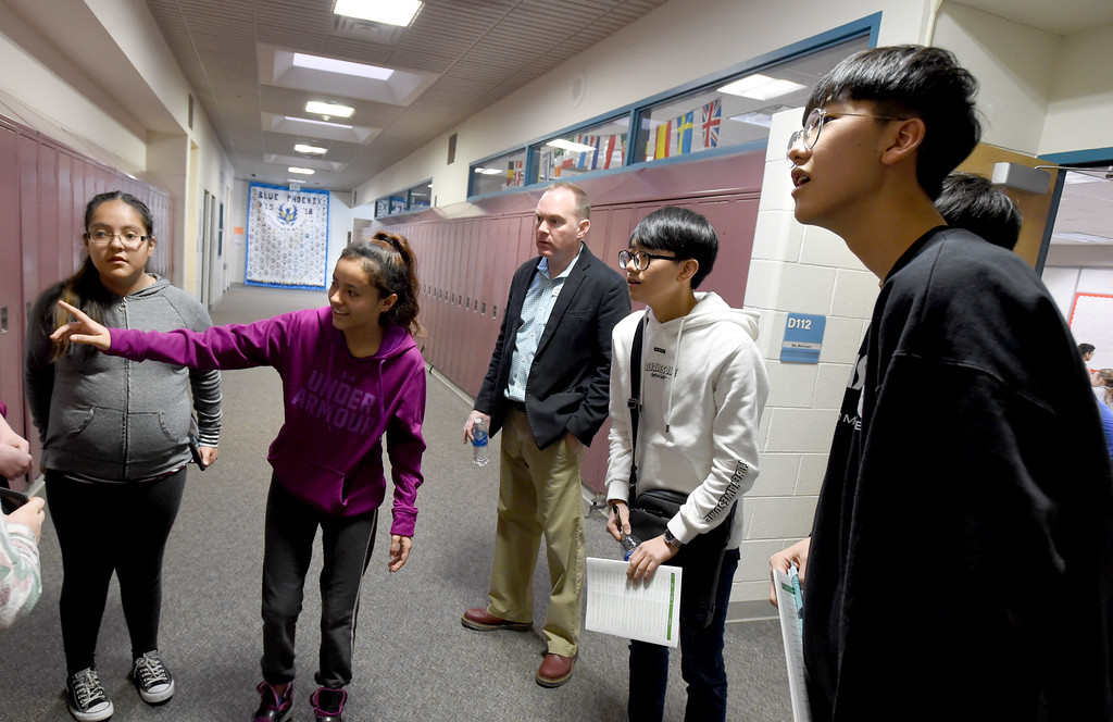 . Narayama Dones-Vega, left, shows the South Korean Students around the school. South Korean high school students  visited Westview Middle School in Longmont on Thursday as part of NASA\'s GLOBE Program. Cliff Grassmick  Photographer January 11, 2018