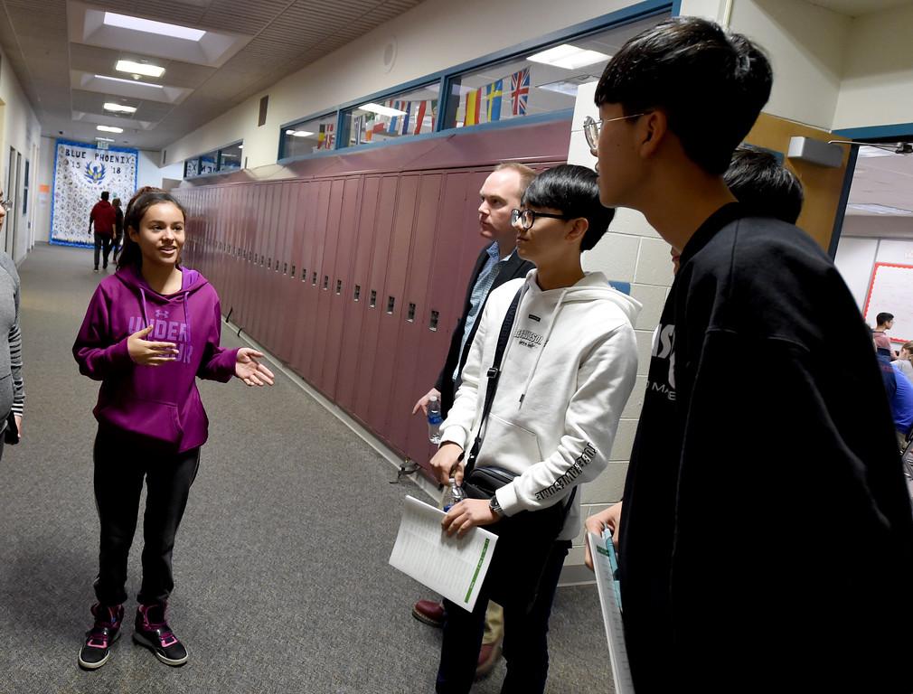 . Narayama Dones-Vega, left, shows the South Korean Students around the school. South Korean high school students  visited Westview Middle School in Longmont on Thursday as part of NASA\'s GLOBE Program. Cliff Grassmick  Photographer January 11, 2018
