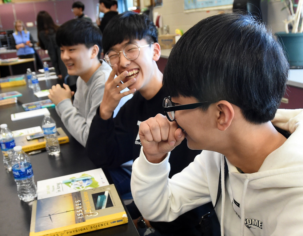 . Jae Hyeon Kim, left, Jae Hyeon Shin, and Su Hyeon Kim  get a little lost in translation in class. South Korean high school students  visited Westview Middle School in Longmont on Thursday as part of NASA\'s GLOBE Program. Cliff Grassmick  Photographer January 11, 2018