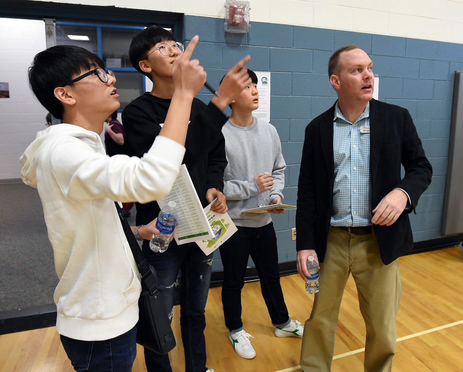 . Su Hyeon Kim, left, Jae Hyeon Shin, and Jae Hyeon Kim South are shown the school gym by Westview science coordinator, Michael O\'Toole. Korean high school students  visited Westview Middle School in Longmont on Thursday as part of NASA\'s GLOBE Program. Cliff Grassmick  Photographer January 11, 2018
