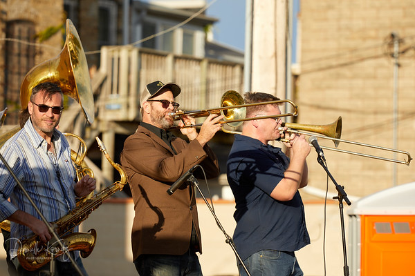 Extra Crispy performs live at South Milwaukee Downtown Market