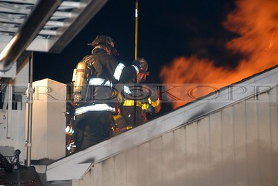 Fire shows through the roof.