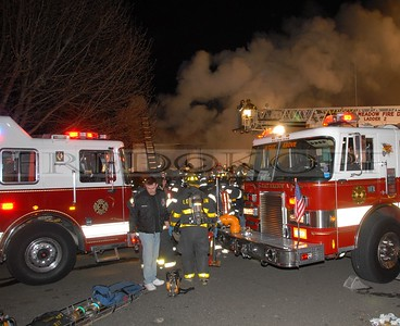 Engine 612 and ladder 619 have the front of the fire building covered.