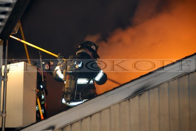 Member uses an 8 foot hook to open up the roof over the attic area.