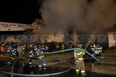 """The East Meadow dispatcher put the call over as """"A house on fire!"""""""