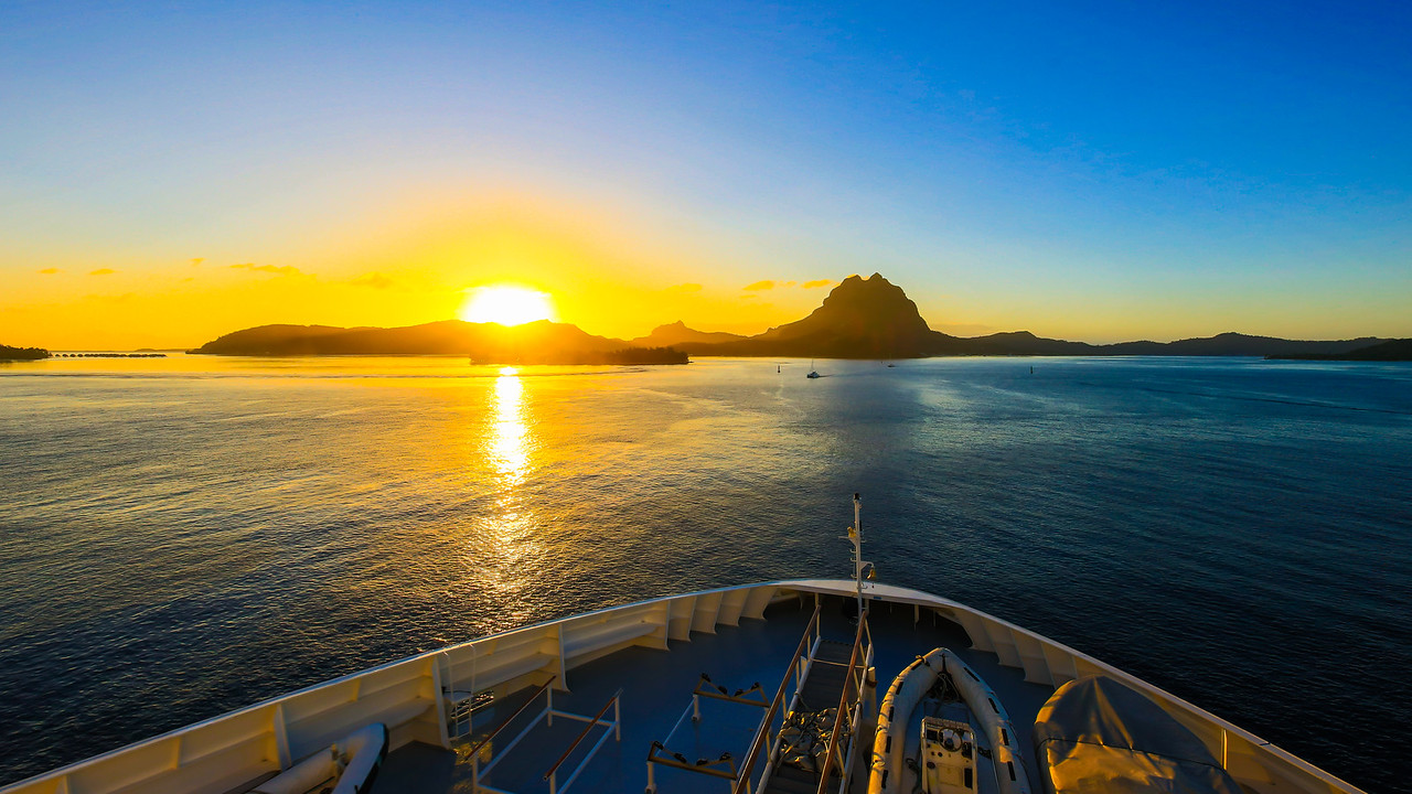 Approaching the island of Bora Bora in the early morning light