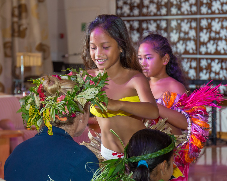 The kids of Huahine sharing their head dresses