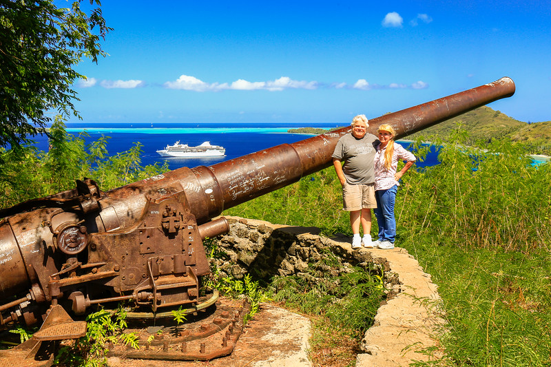Zelle and I next to one of the canons of Bora Bora with the Paul Gauguin in the background